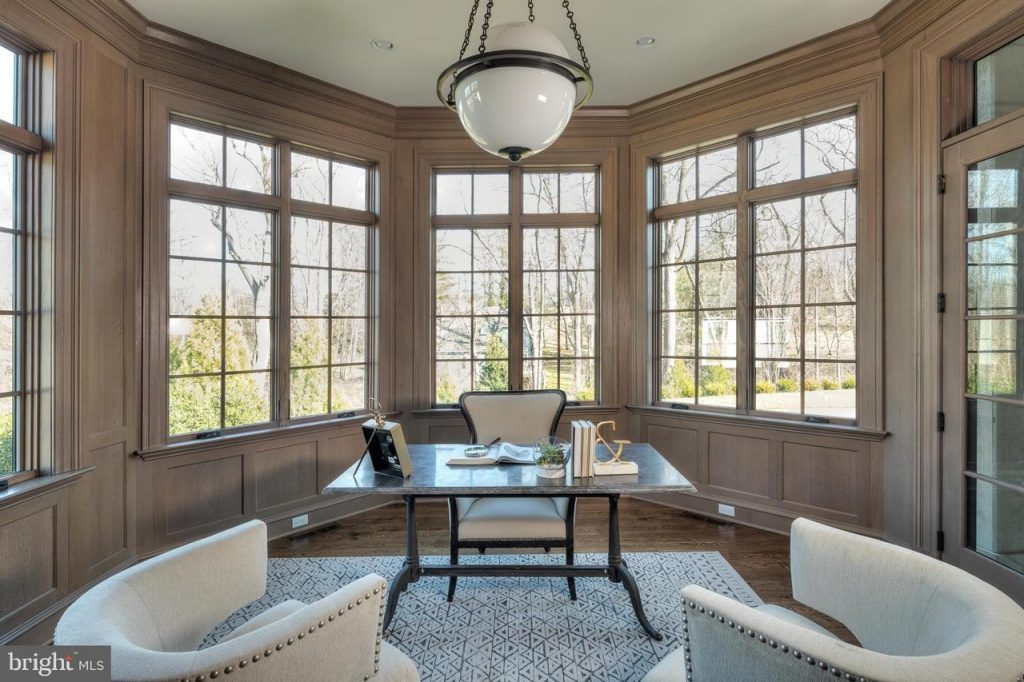 Luxury Home Office with Desk, Two White Accent Chairs Against Bay Window